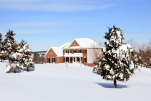 Home with nice winter landscaping